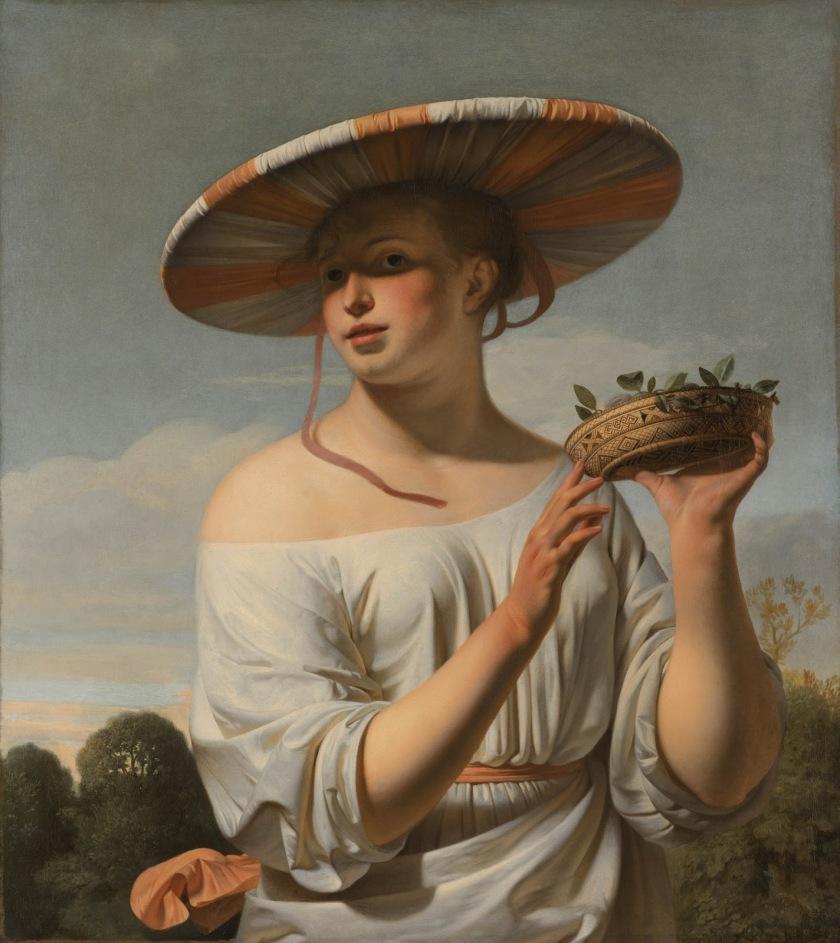 Chica con sombrero grande