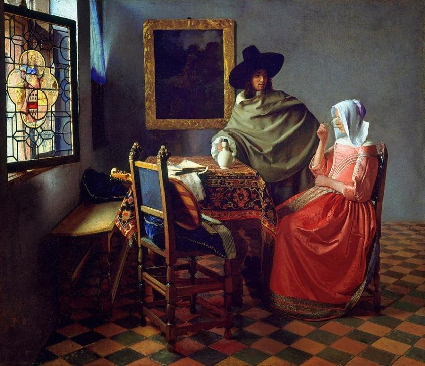 Caballero y dama tomando vino