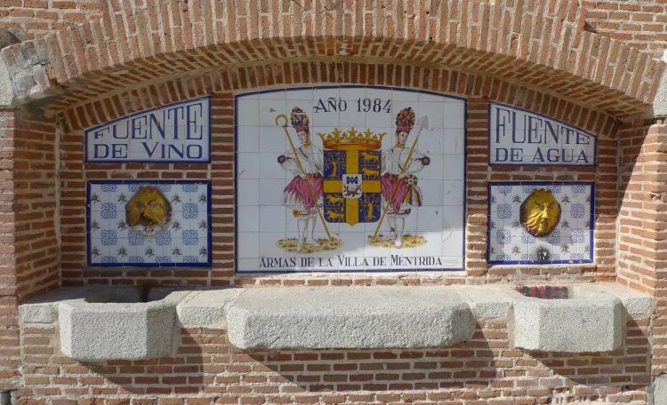 Escudo de armas, fuentes de agua y vino